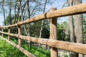 foto of stockade  - wooden fence in a country and blue sky background