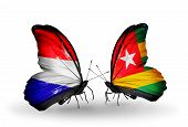 stock photo of holland flag  - Two butterflies with flags on wings as symbol of relations Holland and Togo - JPG