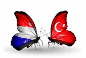 stock photo of holland flag  - Two butterflies with flags on wings as symbol of relations Holland and Turkey - JPG