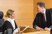 picture of court room  - Lawyer speaking with the judge in the court room - JPG