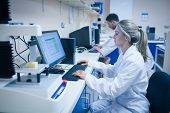 foto of scientist  - Food scientist using technology to analyse cheese at the university - JPG