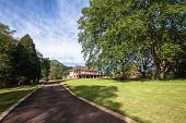 foto of driveway  - Double story house family mansion entrance driveway onto countryside estate - JPG