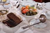 picture of marinade  - Marinaded cucumbers and tomatoes and salty cabbage on a festive table - JPG
