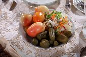 stock photo of marinade  - Marinaded cucumbers and tomatoes and salty cabbage on a festive table - JPG