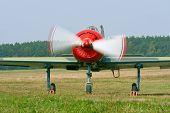 stock photo of propeller plane  - Small propeller plane on airfield before take - JPG