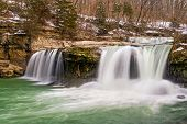 image of cataracts  - Whitewater plunges over Upper Cataract Falls a waterfall in Indiana as snow and ice melts after a very cold winter - JPG