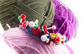 picture of handicrafts  - Variety of different knitting needles with colorful balls of yarn or wool viewed from the top of the needles in a handicraft concept - JPG
