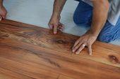 stock photo of laminate  - Installing laminate flooring in new home indoor - JPG