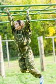 foto of relay  - Tyumen, Russia - September 22, 2012: Avanpost training center on preparation of school students for army. Miles of Fire festival of live history. Teenage girl on climbing frame in militarized relay