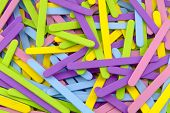 stock photo of popsicle  - Close Up of Colorful Scattered Popsicle Sticks - JPG