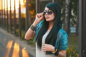 stock photo of swagger  - Girl in sunglasses. sun rays sunset. Portret