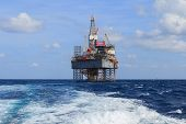 pic of drilling platform  - Offshore Jack Up Drilling Rig Over The Production Platform in The Middle of The Sea - JPG