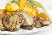 picture of liver fry  - Fried rabbit livers served with potatoes and onions - JPG