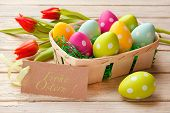 picture of gift basket  - Easter basket with colored eggs and label  - JPG
