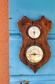 image of barometer  - Vintage barometer and hygrometer on the blue shutters - JPG