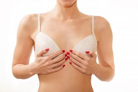 picture of transgendered  - small breasts in white bra isolated on white background - JPG