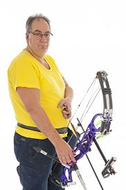 picture of longbow  - Guy with yellow shirt and jeans standing with a longbow - JPG