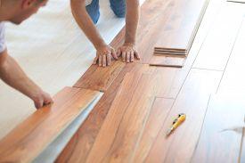 foto of laminate  - Installing laminate flooring in new home indoor - JPG