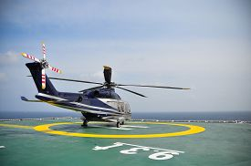 picture of helicopters  - Helicopter parking on helideck and waiting passenger - JPG