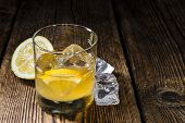 stock photo of close-up shot  - Glass with Whiskey Sour and ice cubes  - JPG