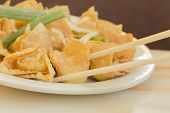 picture of chinese restaurant  - Chinese cheese wontons appetizer at restaurant served with green onion and bean sprouts - JPG