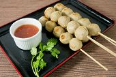 pic of meatball  - Food and Cuisine Grilled Meatballs on Wooden Skewer Served with Sweet Spicy Sauce and Green Coriander - JPG