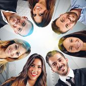 picture of collaboration  - Happy faces of a team that collaborates - JPG