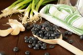 stock photo of green turtle  - Black turtle beans green onions and garlic cloves as cooking ingredients - JPG