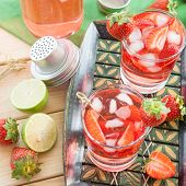 foto of sangria  - Homemade strawberry lemonade or sangria with fresh lime - JPG