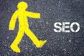 stock photo of pedestrians  - Yellow pedestrian figure on the road walking towards SEO - JPG