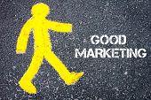 pic of pedestrians  - Yellow pedestrian figure on the road walking towards GOOD MARKETING - JPG