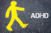 picture of pedestrians  - Yellow pedestrian figure on the road walking towards ADHD - JPG