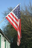 pic of north star  - stars and stripes hanging outside a building - JPG