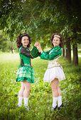 image of wig  - Two young beautiful girl in irish dance dress and wig posing outdoor - JPG