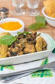 picture of curry chicken  - stew chicken in curry with mushrooms on wooden table - JPG