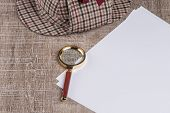 pic of private investigator  - Paper sheets and magnifying glass on Old Wooden table - JPG