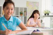 picture of schoolgirl  - Asian schoolgirl listening to the teacher in the class - JPG