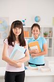 stock photo of foreground  - Smiling Vietnamese female students in the class - JPG