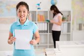 pic of schoolgirl  - Cheerful Vietnamese schoolgirl holding blank sheet of paper - JPG