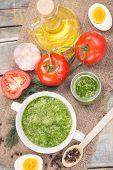 pic of pesto sauce  - sauce of pesto near a tomato olive oil and eggs in a studio - JPG