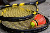 foto of shuttlecock  - Two crossed speedminton rackets with shuttlecock on them - JPG