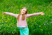 picture of pullovers  - Cute little girl playing in a park - JPG