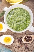 picture of pesto sauce  - sauce of pesto near a pepper olive oil and eggs in a studio - JPG