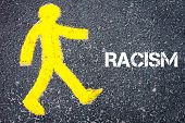 picture of pedestrians  - Yellow pedestrian figure on the road walking towards RACISM - JPG