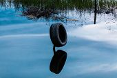 stock photo of life-boat  - the second life of a car tire as the buffer for the boat  - JPG