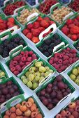 picture of stall  - Close up of various red fruits on a market stall - JPG