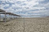 foto of gazebo  - Row of gazebo on the beach in Spring - JPG