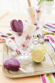 stock photo of popsicle  - Homemade frozen popsicles with fresh fruits and lime - JPG