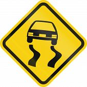 pic of slippery-roads  - Colombian road warning sign - JPG