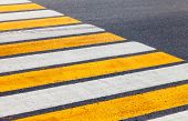 image of pedestrian crossing  - Pedestrian crossing with white and yellow lines - JPG